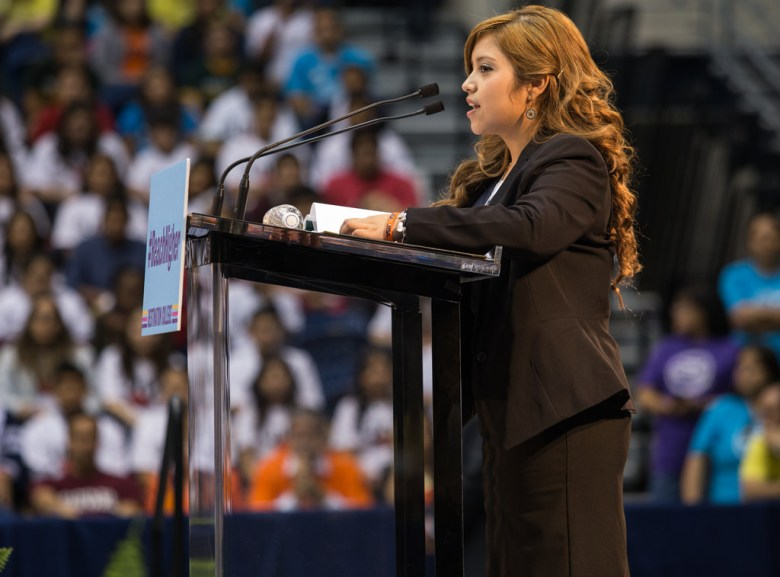 Rosio Alvarado, a senior at McCollum High School who is headed to attend UTSA, introduces the first lady Michelle Obama during her  visit to UTSA to talk about her college enrollment initiative during College Week.  Photo by Scott Ball.