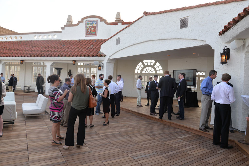 Guests of the Urban Land Institute Project Tour mingle on the 10th floor terrace at the St. Anthony Hotel. The once gravel-topped expanse is now covered with Brazilian hardwood. Photo by Annette Crawford.