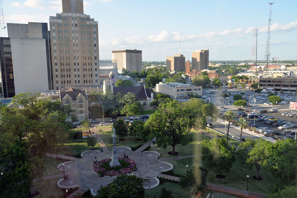 A view from the 10th floor terrace of the St. Anthony Hotel, looking out over the revitalized Travis Park and toward the new Tobin Center for the Performing Arts. Photo by Annette Crawford.