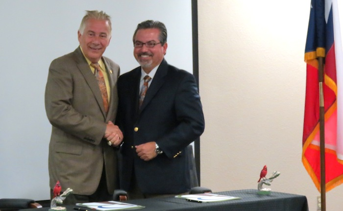 UIW President Louis Agnese and Brooks City Base President and CEO Leo Gomez shake hands on an agreement for BCB to host UIW's new medical school June 10, 2014. Photo by Erin Hood.