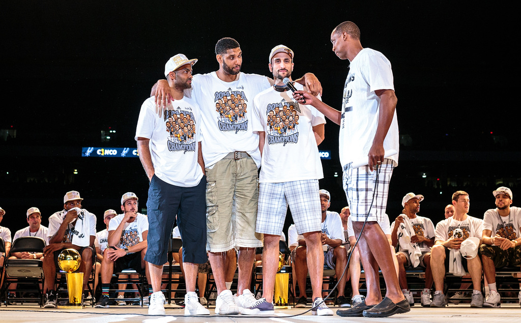 """Former Spur Sean Elliot questions """"The Big Three"""" Tony Parker, Tim Duncan, and Manu Ginóbili during the Spurs celebration at the Alamodome of their 2014 NBA Finals victory. Photo by Scott Ball."""