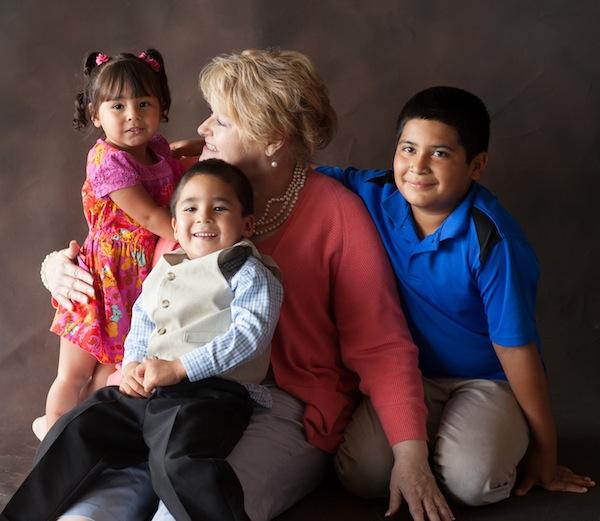 LeQuinne Ferebee of Child Advocates San Antonio (CASA) with CASA children Kassandra, George and Alyssa. Photo courtesy of Will Langmore Photography.