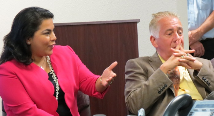 UIW President Louis Agnese Jr. and District 3 Councilwoman Rebecca Viagran discuss their support of an agreement for Brooks City Base to host UIW's new medical school in the Southside June 10, 2014. Photo by Erin Hood.