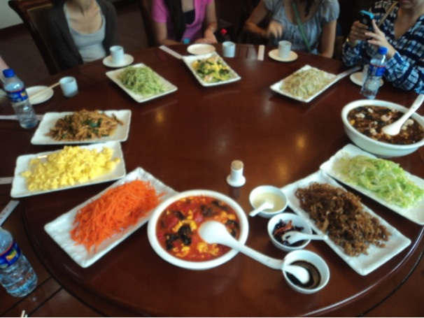 """The UTSA Honors study abroad group enjoyed several meals served on rotating, """"Lazy Susan"""" style tables during their stay. Photo courtesy Salma Mendez and Zack Dunn."""