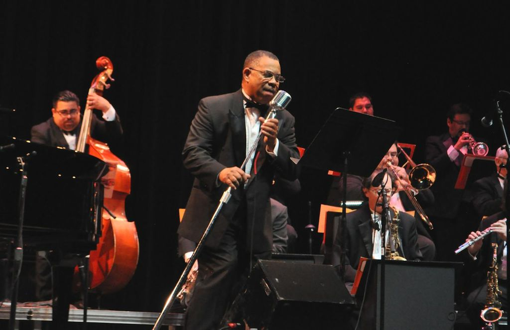 Saxophonist and New Orleans native Pierre Poree sings with Doc Watkins and his Big Band on stage at The Empire Theatre. June 10, 2014. Photo by Iris Dimmick.