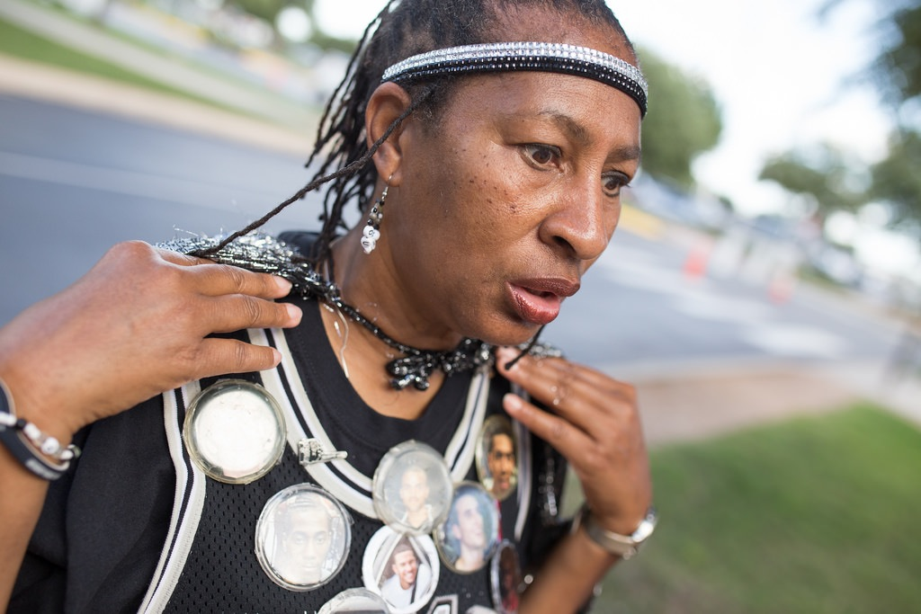 Earline Miller realizing she can not find her lucky Tim Duncan button. She later found it. The Spurs won Game 1 of the 2014 NBA Finals against the Miami Heat 110-85. Photo by Scott Ball.