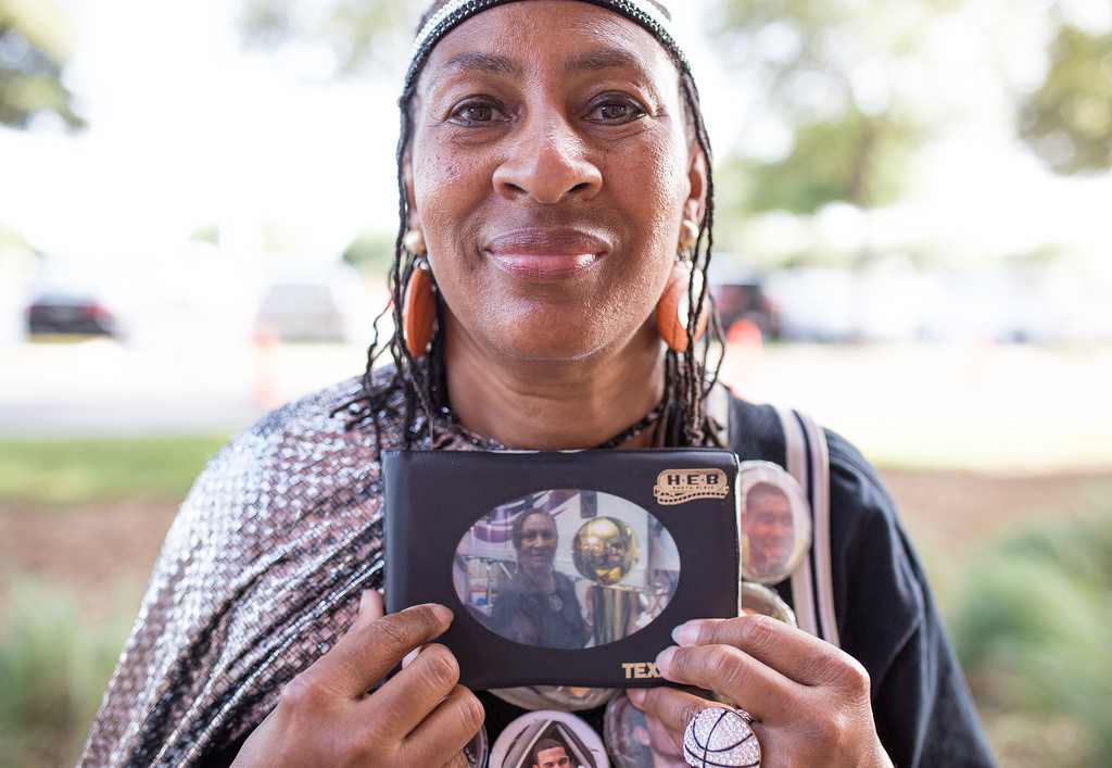 Earline Miller proudly displays a photo of one of her most special moments, when she got to hold the Larry O'Brien Championship Trophy. Photo by Scott Ball.
