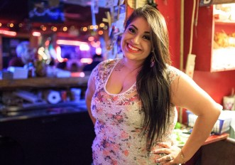 Tony Lopez' daughter, Earnestine Hernandez poses behind the bar during Game Three of the NBA Finals on June 10, 2014. Photo by Scott Ball.