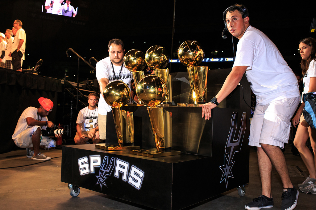 All five Larry O'Brien championship trophies are wheeled in during the Spurs celebration at the Alamodome of their 2014 NBA Finals victory. Photo by Scott Ball.