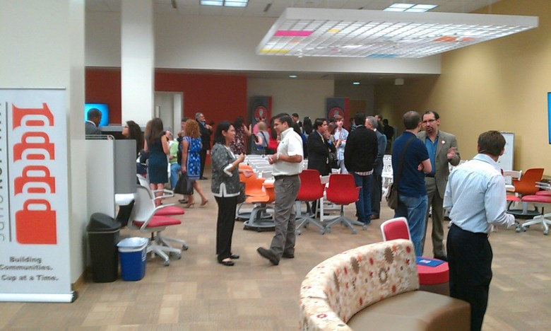 The grand opening of Cafe Commerce drew a number of local business leaders and entrepreneurs. Photo by Andrew Moore.