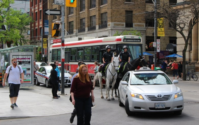 Cars, bicycles, streetcars -- even horses -- share the downtown streets. Photo by Page Graham.