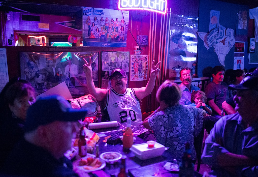 """Joe Robles, a.k.a. """"The Screamer,"""" yells from across the bar during Game Three of the NBA Finals on June 10, 2014. Photo by Scott Ball."""