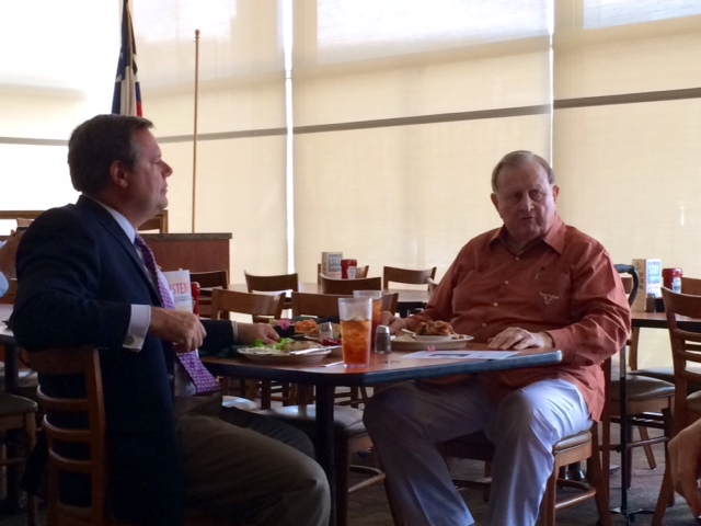 Jeff Judson and Red McCombs discuss their opposition to the VIA Modern Streetcar project at an informational luncheon on June 16.