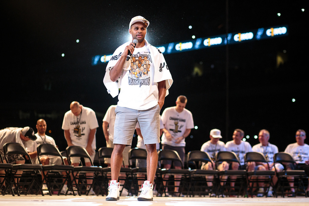 Patty Mills addresses a packed stadium with his team during the Spurs celebration at the Alamodome of their 2014 NBA Finals victory. Photo by Scott Ball.