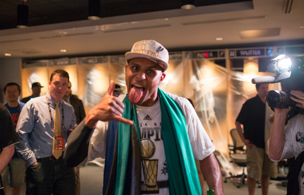 Patty Mills celebrates the Spurs' win of the 2014 NBA Finals. Photo by Scott Ball.