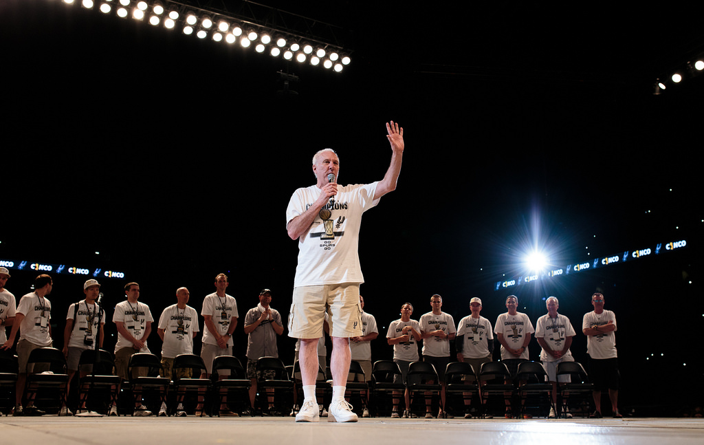 Gregg Popovich addresses the crowd during the Spurs celebration at the Alamodome of their 2014 NBA Finals victory. Photo by Scott Ball.