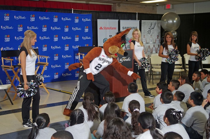 The Spurs Coyote and the Silver Dancers pump up the crowd before a press conference announcing a new Spur-sponsored Learn and Play Center at Bowden Elementary School on June 6, 2014. Photo by Juan Garcia.