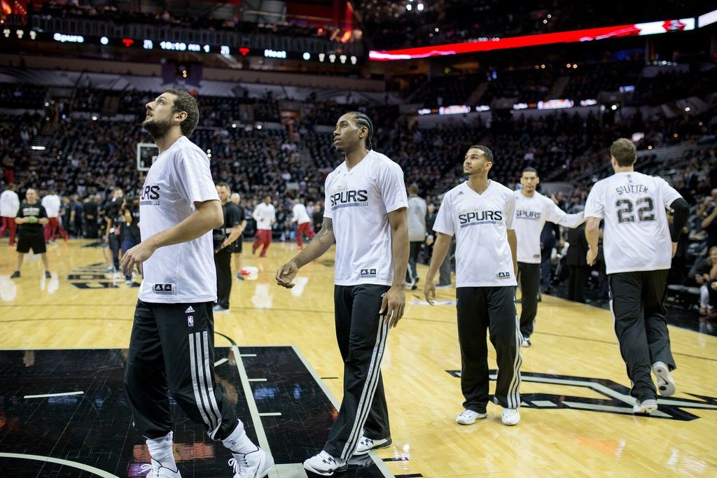 The younger side of The Spurs (from left) Marco Belinelli, Kawhi Leonard, Cory Joseph, Tiago Splitter, and Danny Green during Game 1 of the 2014 NBA Finals. Photo by Scott Ball.