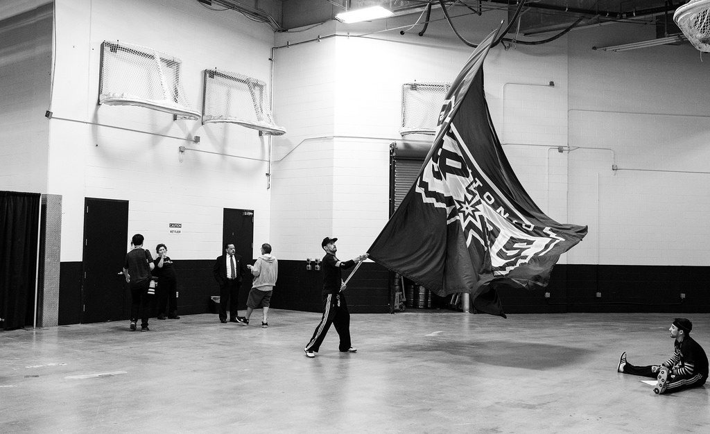 A Spurs team member practices waving the team flag before Game 2 of the NBA Finals June 8, 2014. Photo by Scott Ball.