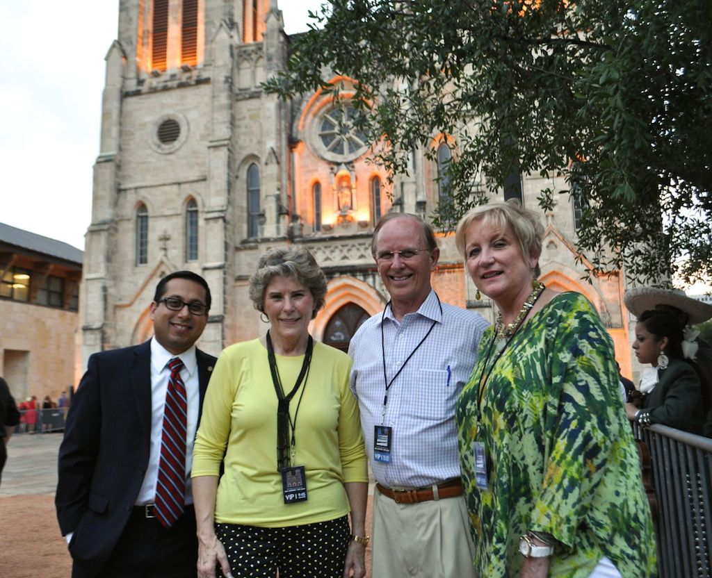 District 1 Councilman Diego Bernal, Bexar County Sheriff Susan Pamerleau, Bexar County Judge Nelson Wolff, and District Attorney Susan Reed pose for a photo during the opening night of the art installation in Main Plaza. Photo by Iris Dimmick.