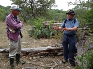 Todd Votteler and Malcolm Cleaveland stand next to a dead tree. Photo by Robert Rivard.