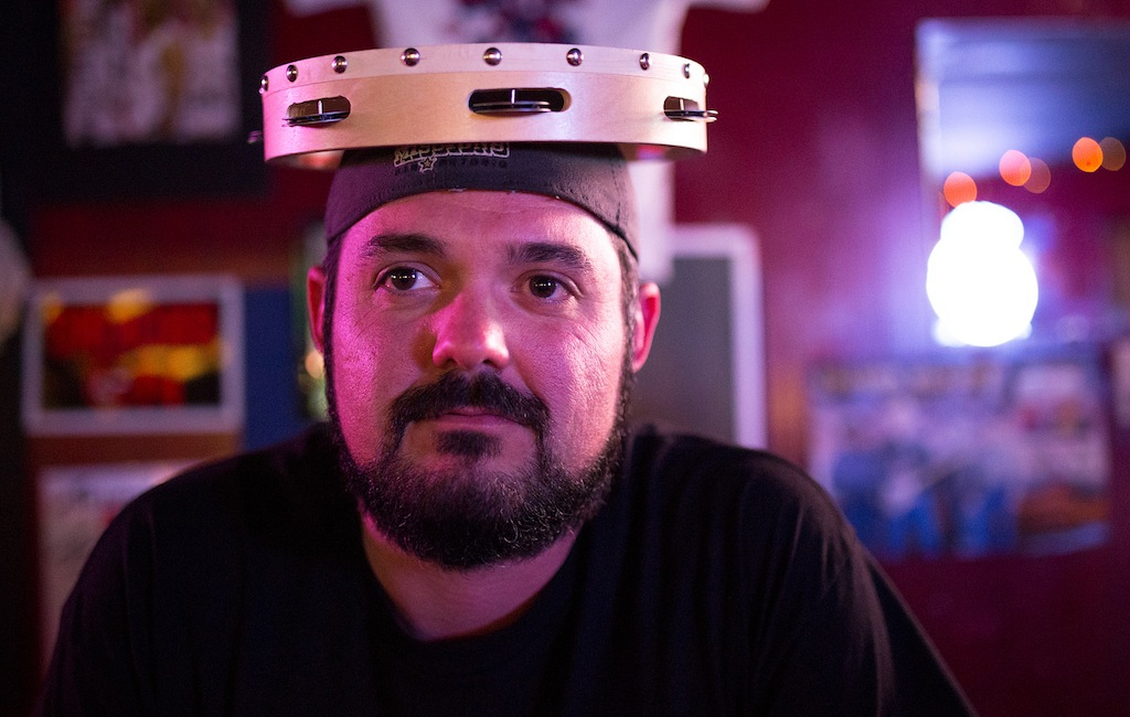 Zac Harris balances a tambourine on his head during a commercial break for Game Three of the NBA Finals on June 10, 2014. Photo by Scott Ball.
