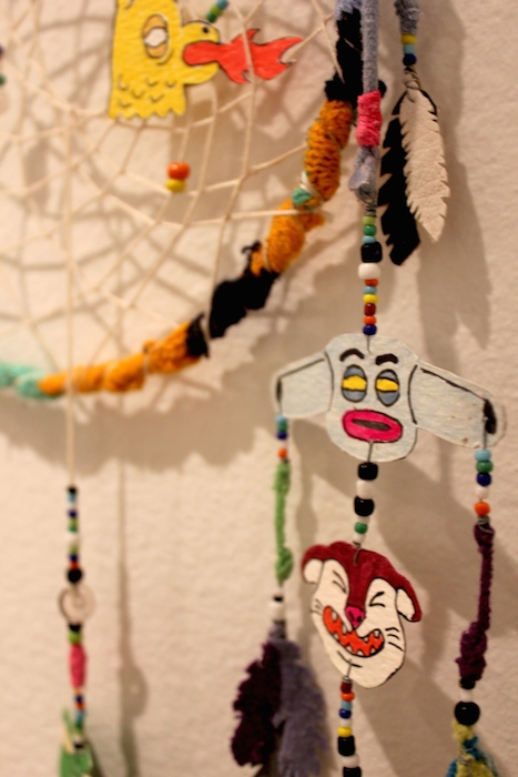 """Jason Villegas' """"Soft Crystal Cathering"""" – a dreamcatcher turned comic book strip – at the Guadalupe Cultural Arts Center's exhibit, """"Flatland."""" July 11, 2014. Photo by Melanie Robinson."""