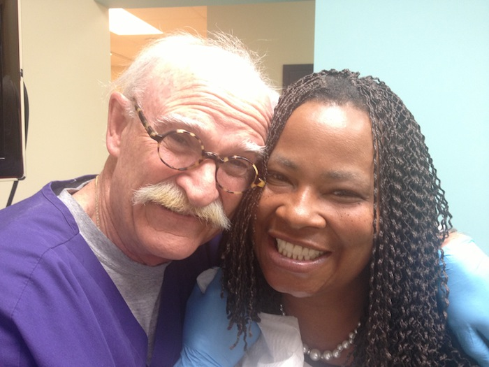 Volunteer dentist Dr. Richard Carnahan helps patient Babetta Lewis show off her new smile. Photo by Sarah Martinez.
