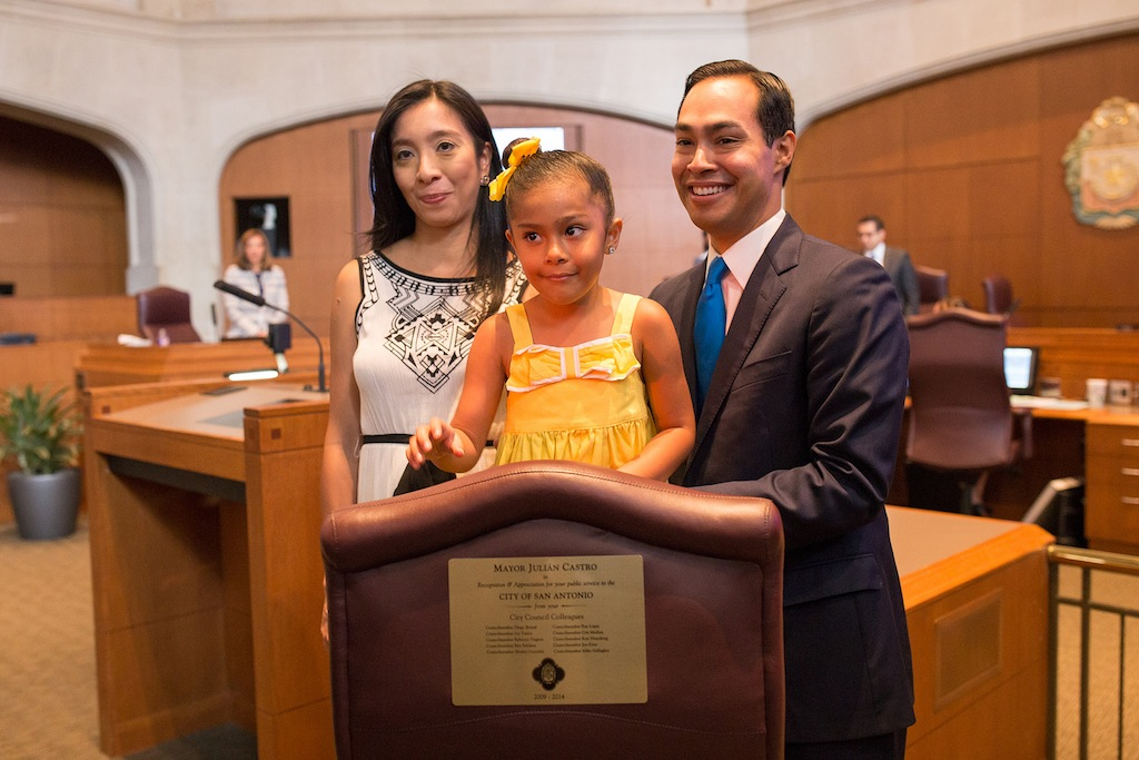 Outgoing Mayor Julián Castro stands with his wife Erica while daughter Carina tests out the mayoral chair. Photo by Scott Ball.