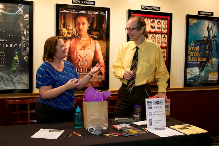 """Cinema Tuesdays volunteer Arlene Gauthier talks with TPR's Director of Marketing and Community Engagement Nathan Cone before the screening of """"12 Angry Men"""" at the Santikos Bijou Cinema Bistro. Photo by Taylor Browning."""