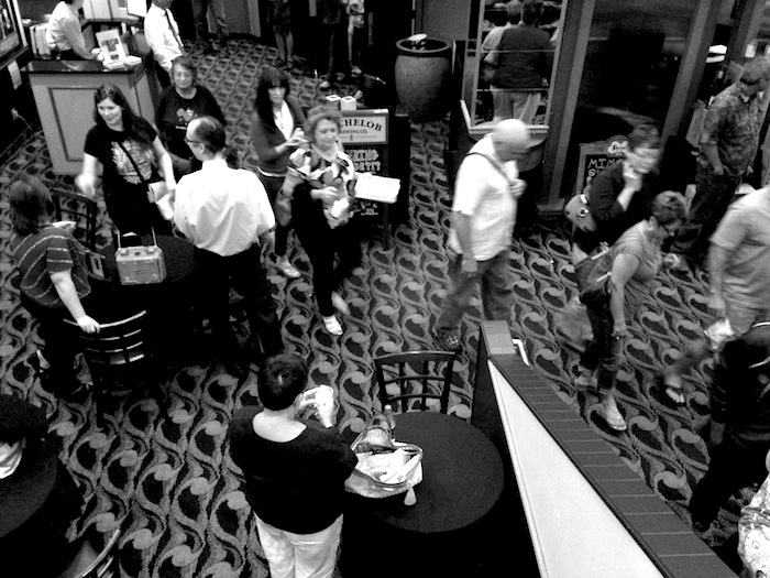"""Patrons mingle in the Santikos Bijou Cinema Bistro lobby after the NPR Cinema Tuesday showing of """"12 Angry Men."""" Photo by Taylor Browning."""
