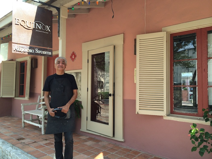 Alejandro Sifuentes, owner of Equinox, stands in front of his shop in La Villita. Photo by Katherine Nickas.