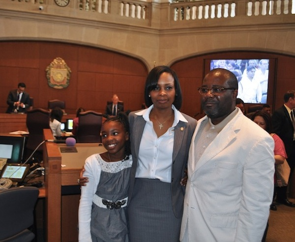 Mayor Ivy Taylor stands with her husband Rodney Taylor and daughter Morgan moments after Ivy was sworn in as mayor. Photo by Iris Dimmick.