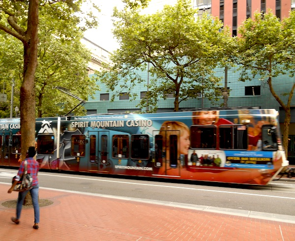 Corporate advertising helps offset the cost of streetcar operation in Portland. Photo by Don Mathis.