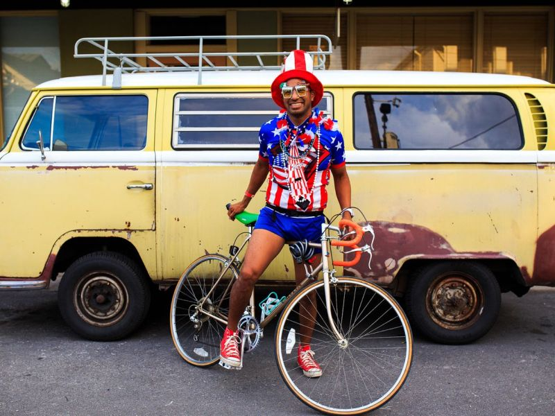 Miguel San poses for a photo in front of a vintage Volkswagen bus on Fourth of July, 2014. Photo by Scott Ball.