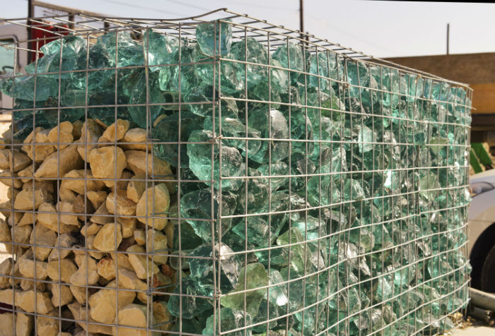 Gabion fences, typically filled with rock, will be filled with a mixture of rock and recycled glass, which will be lit at night for drivers passing the Do-Seum. Photo by Brantley Hightower.