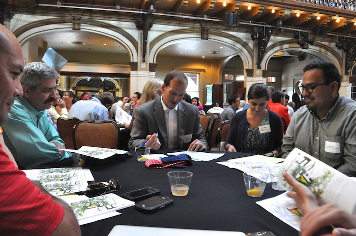 A work group table discusses their most and least favorite aspects of the designs for Civic Park. Photo by Iris Dimmick.