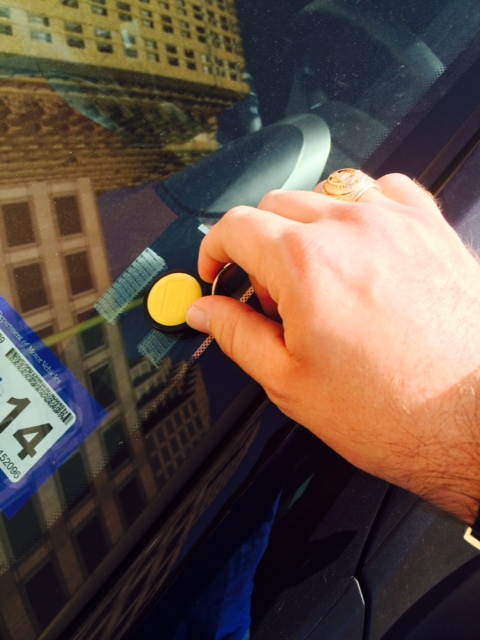 A Hertz On Demand customer scans his keychain on the window of a rental car in downtown San Antonio. Courtesy photo.