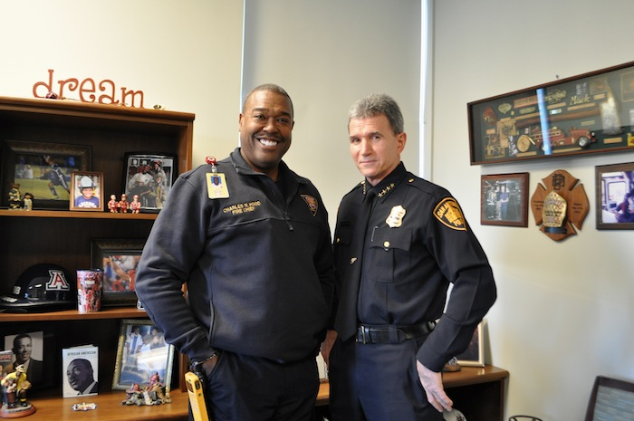 San Antonio Fire Chief Charles Hood and San Antonio Police Chief William McManus pose for a photo in Hood's office in the Public Safety Headquarters. Photo by Iris Dimmick.