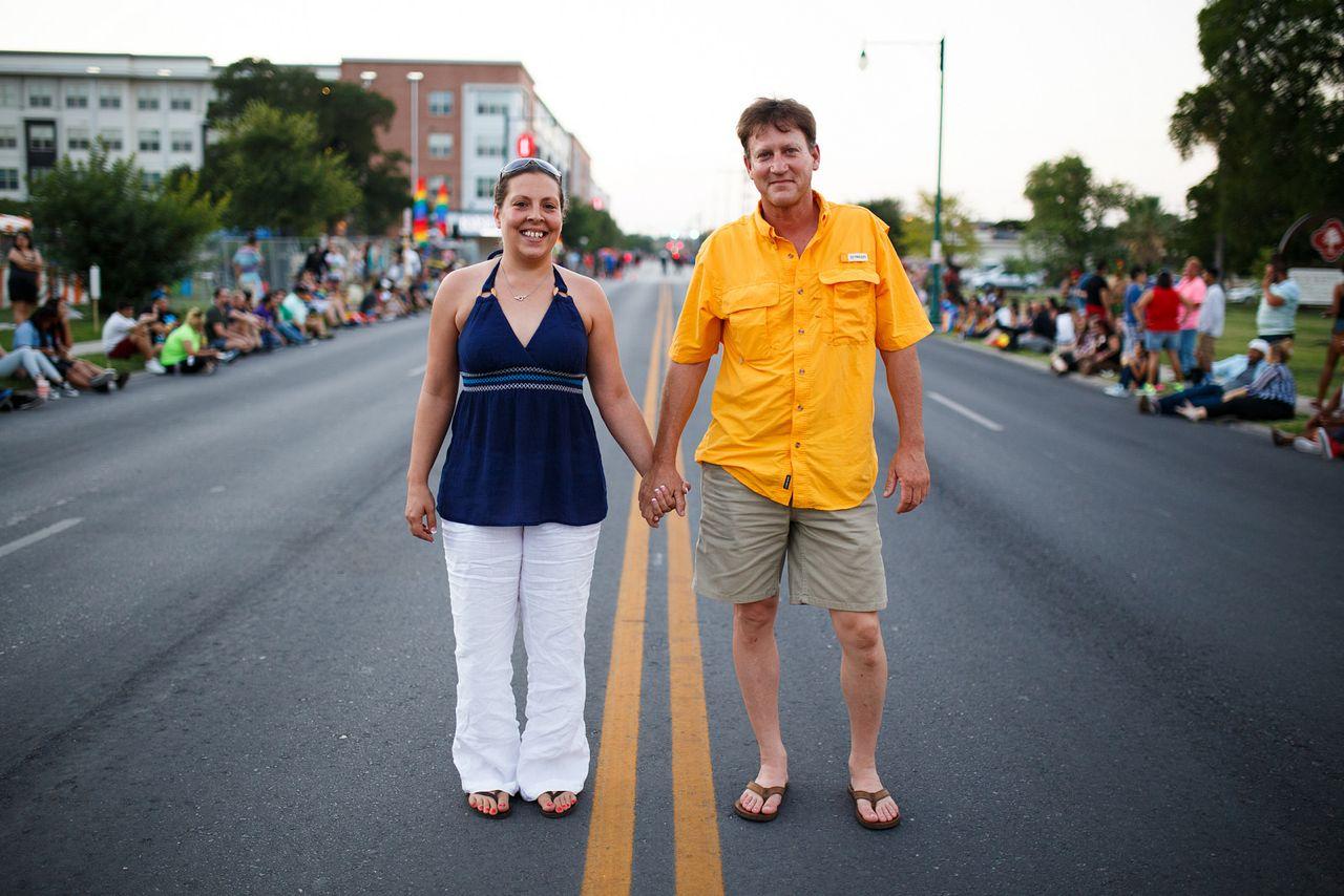 "Keith Thompson and Tiffanie Lackey at the 2014 Pride ""Bigger Than Texas"" Parade. Photo by Scott Ball."