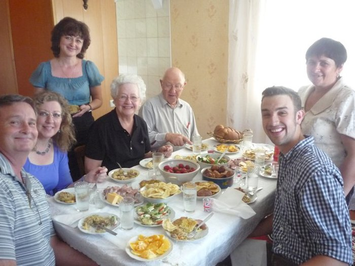 Mama Nina (far back right) prepared the spread for my family as they visited Ukraine from the States. Photo courtesy of Adam Tutor.