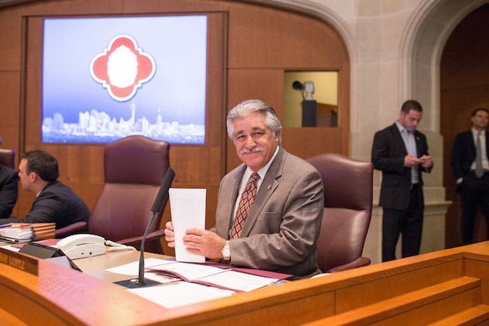 District 6 Councilman Ray Lopez gets organized before the vote. Photo by Scott Ball.