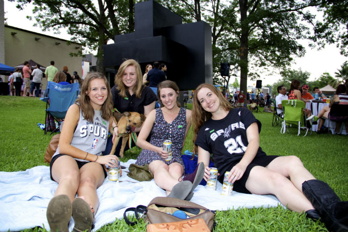 Guests sit on the lawn at the McNay Art Museum at Second Thursday. Photo by Tommie Ethington