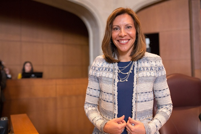 District 5 Councilwoman Shirley Gonzales poses for a photo before the Council's special session begins. Photo by Scott Ball.