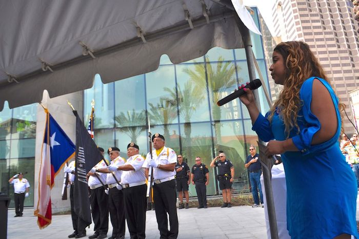 Color Guard from Veterans of Foreign Wars Post 76 hold their post during the U.S. National Anthem at the unveiling of the Medal of Honor River Portal connecting the San Antonio River to the Tobin Center for the Performing Arts July 3, 2014. Photo by Iris Dimmick.