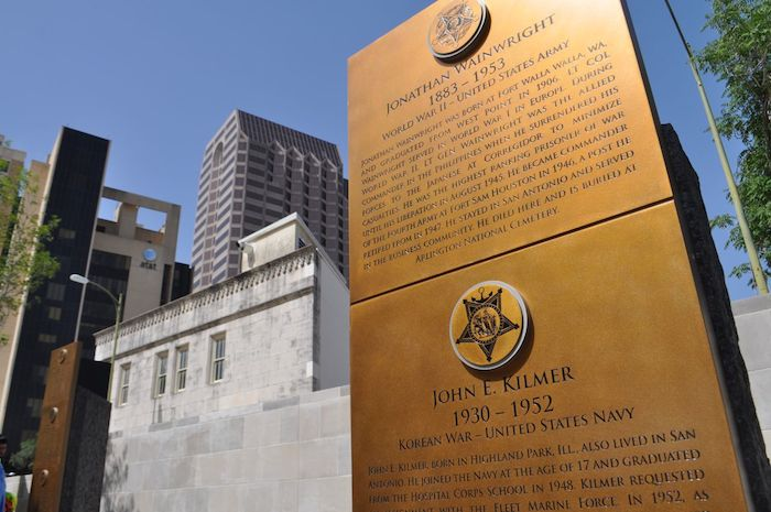 """The """"sentinel"""" monoliths engraved with the names and stories of 32 U.S. Military veterans make up the Medal of Honor River Portal connecting the San Antonio River to the Tobin Center for the Performing Arts July 3, 2014. Photo by Iris Dimmick."""
