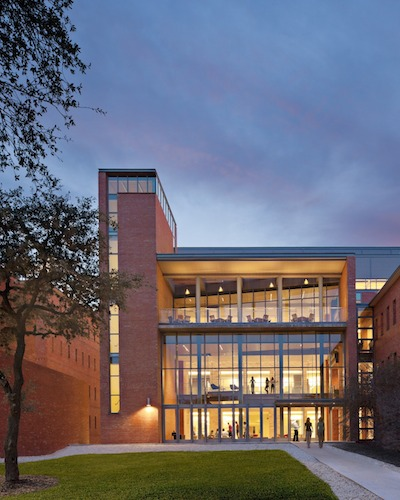 The Center's exterior, lit up against the evening. Photo by Robert Benson Photography.