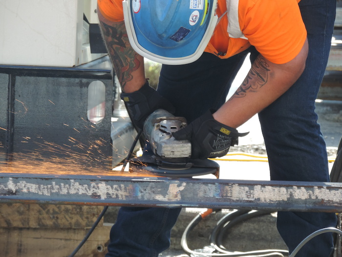 A worker welds track for the Kansas City streetcar. Photo courtesy of Alex Miller, Parson and Associates.
