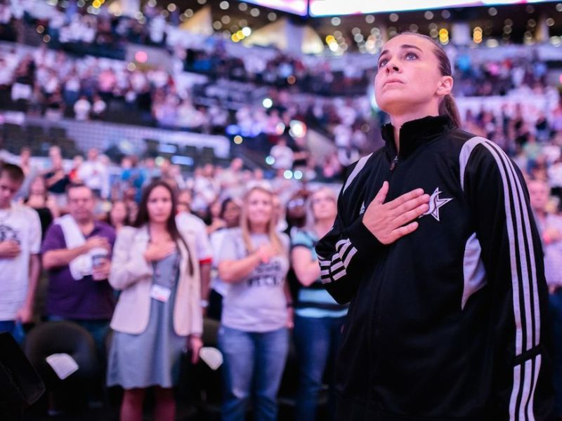 Becky Hammon listens to the National Anthem before her last game with the San Antonio Stars. Photo by Scott Ball.
