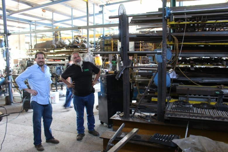Billy Lambert and Oscar Hernandez, Sr. discuss a grill being built for a French & Michigan client. Photo by Page Graham.